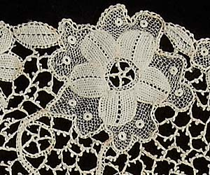 Detail from a Youghal collar showing the loops of stitches around the motifs and outer edge and the ground of picot-decorated bars, c. 1900 (JPO.1.2002). Image retrieved from The Lace Guild (www.laceguild.org)