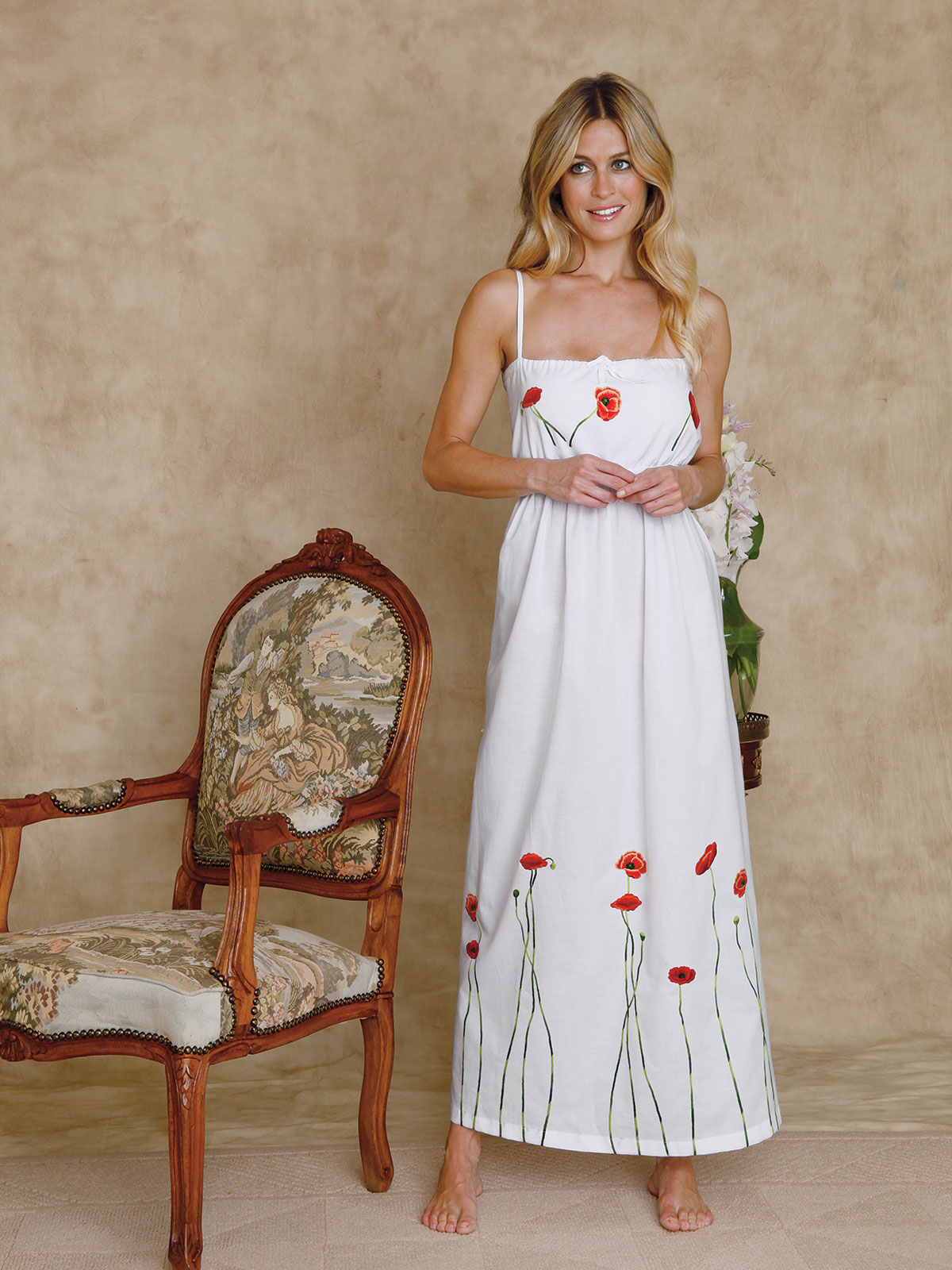 Poppies in Bloom: This enchanting gown is lovingly crafted of White 100% cotton batiste